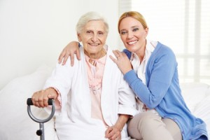 nurse practitioner with resident at senior living community