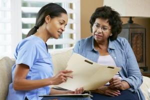 nurse practitioner showing patient chart